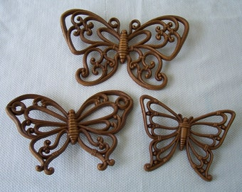 Vintage Homco brown rattan look plastic wall decor butterflies.    C2-34
