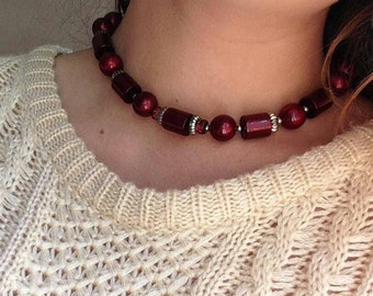 1950s cranberry lucite bead necklace with tube beads and rondelles