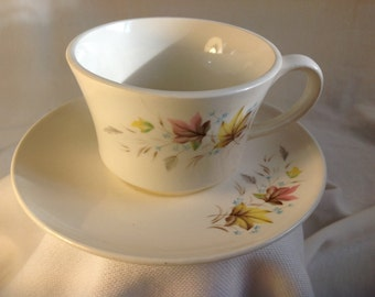 Pretty pink and yellow tea cup and saucer