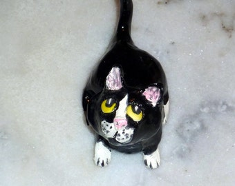 Sweet little black and white kitty is the purrfect sold by Outsider Artist
