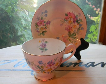 Clarence Bone China Tea Cup & Saucer. Made in England. Wild flowers pattern. collectible china