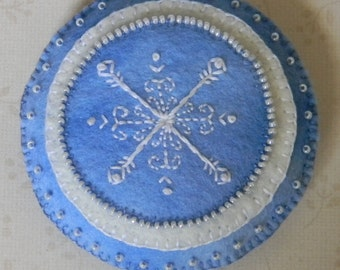 light blue round hand embroidered and beaded snowflake ornament