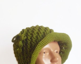 Handmade green crochet hat with green flowers.