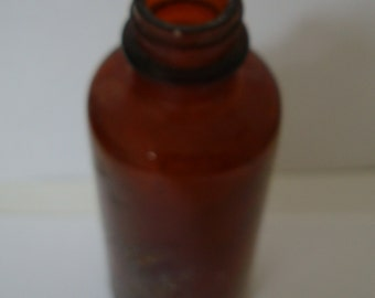 OLD MEDICINE  BOTTLE, found in ground 5 inch tall, 1 3/4 inch round, screw top missing, condition: see description