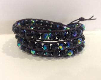 Black faceted fire polished glass triple wrap bracelet.