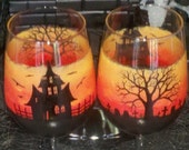 Haunted Halloween hand painted wine glasses.