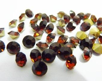 24 rhinestones SS23, Ø5mm, dark topas, round
