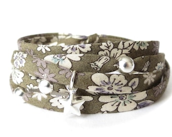 Fall color fabric wrap bracelet in olive green florals with silver charms, UK jewellery gift idea for sister, ribbon jewellery