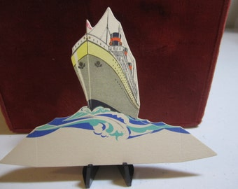 Art deco 1920's unused Buzza die cut place card colorful graphics of ocean liner cruise ship and waves
