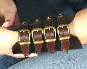 Hard leather wristband with 4 buckles
