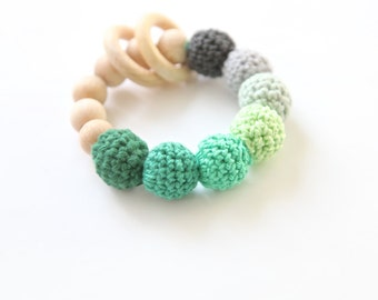 Green and grey one nursing bracelet, rattle for baby. Teething ring toy with crochet wooden beads.