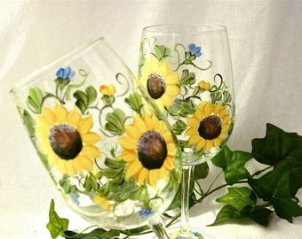 Sunflowers hand painted on a pair of wine glasses