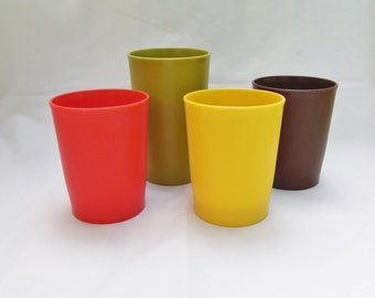 Four Tupperware Cups Yellow Brown Orange and  Larger Green Plastic Glasses Made in USA