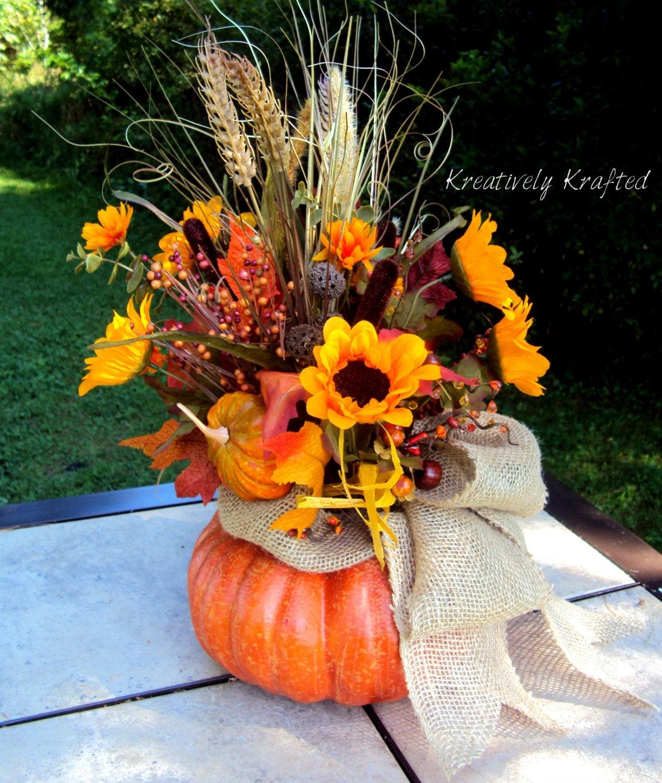 Large pumpkin autumn floral arrangement table by