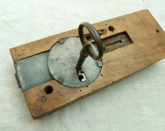 French antique door lock and key....good working order.