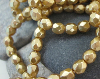 Vintage  Czech Glass 3mm Facet Beads in Pearlized Gold.  3 dz.