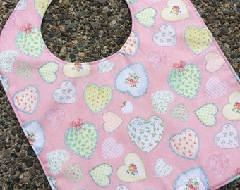 NEWBORN Bib: Hearts Tossed on Pink with Block Hearts on Back, Personalization Available