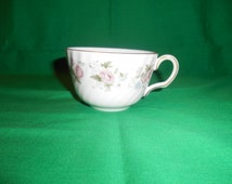 One (1), Bone China Tea Cup, from Minton, in the Spring Bosquet Pattern.