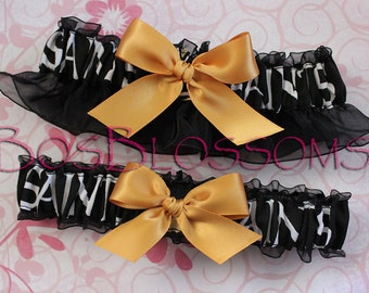 NEW ORLEANS SAINTS fabric handmade on black organza into bridal keepsake garters - garter set w golden bow - size xs s m l xl