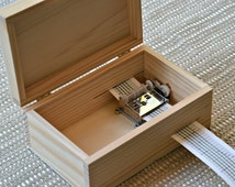 DIY Music Box. Wood Box with locker. Music Mechanism. 2 pieces of printed cardboard cut to size.