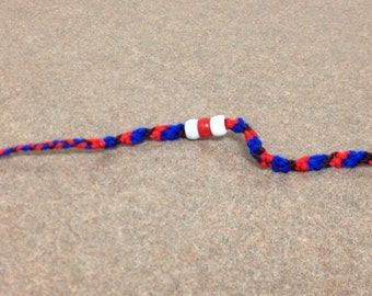 Red, blue, brown, and white beaded friendship bracelet