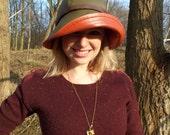 Lola rain hat in dark olive green and rust orange
