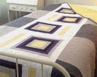 This Modern quilt pattern looks great in a 20 something's loft or a dorm room, clean lines and plenty of negative space for personalization