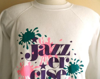 vintage 80's Jazzercise white fleece graphic sweatshirt raglan sleeve fleece crew neck bright pastel pink teal purple paint splatter logo
