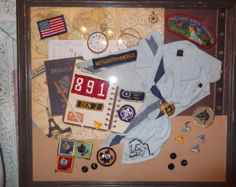 assemblage of Boy Scouts of America, patches, scarf, pins,buttons, shadowbox of boy scouts