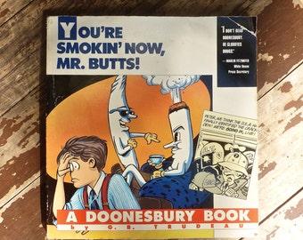 "A Doonesbury Book, Vintage ""You're Smokin' Now Mr. Butts"", 1980 Comic, Gary Trudeau Cartoonist, Anti-Cigarette Ad Campaign, Political Satire"