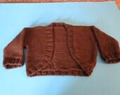 Hand knit chocolate brown baby girl shrug