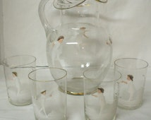 Mary Gregory styled pitcher and tumblers set