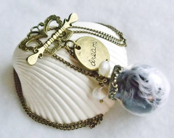 Glass orb necklace on antique bronze chain with butterfly clasp and bronze dream charm