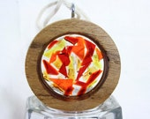 Small teak round, filled with red, orange and yellow stained glass
