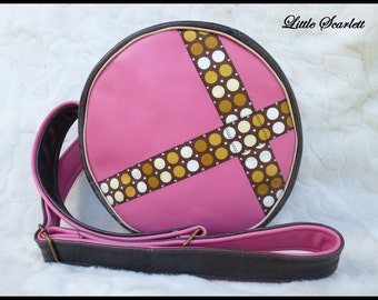 Pink and brown leather round bag