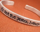 It's not the years, honey, it's the mileage - A Hand Stamped Bracelet in Aluminum or Sterling Silver
