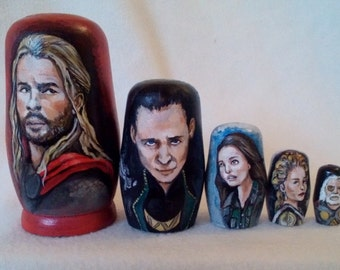 A modern take on Russian Stacking Dolls Thor Set. Each set is hand drawn, painted and varnished.