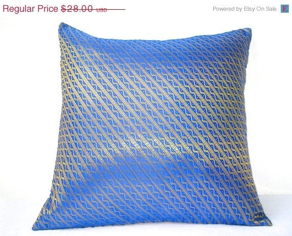 Unavailable listing on etsy for Blue and gold pillows