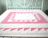 Vintage Red and White Quilt all hand quilted.