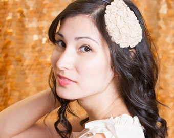 Ivory colored vintage lace flower headband, accented with pearl