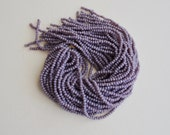 light lavender purple opaque faceted glass beads (1 strand)