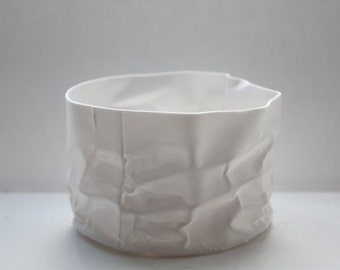 Crumpled paper looking white vessel made out of English fine bone china