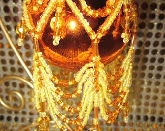Beautiful vibrant, orange and gold beaded bauble ornament cover, tree decoration