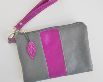 Leather wristlet or clutch in gray with dark fuchsia.