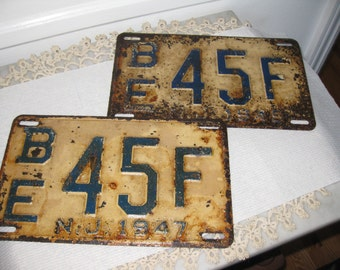 "VINTAGE 1945 and 1947 LICENSE PLATES Same Number Different Years 6 1/2"" x 10 3/4"""