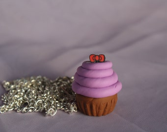 Adorable Purple Frosting Cupcake Necklace With Tiny Bow Topping.