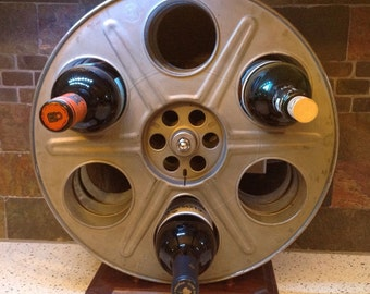 WINE RACK made from vintage 35mm movie motion picture film reels ~~unique~~art deco~~
