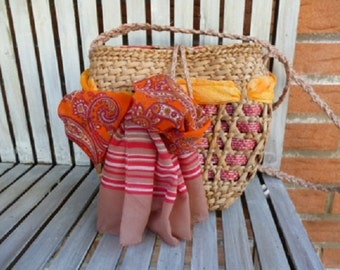 straw bag is made and hand-decorated with straw braid handles