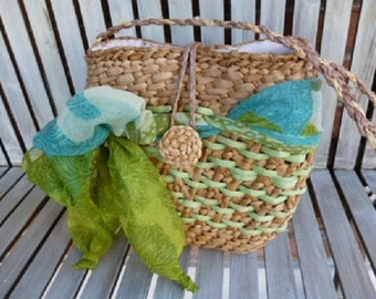 straw bag is made and decorated by hand with green scarf variant straw braid handles cm22x22