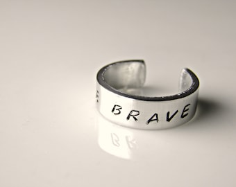 Be Brave. Hand stamped custom made ring. Divergent movie inspired.